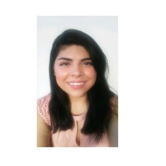 Latina woman wearing pink shirt, smiling