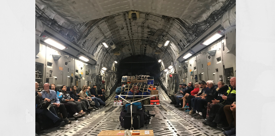 image of people inside the cargo hold of a plane